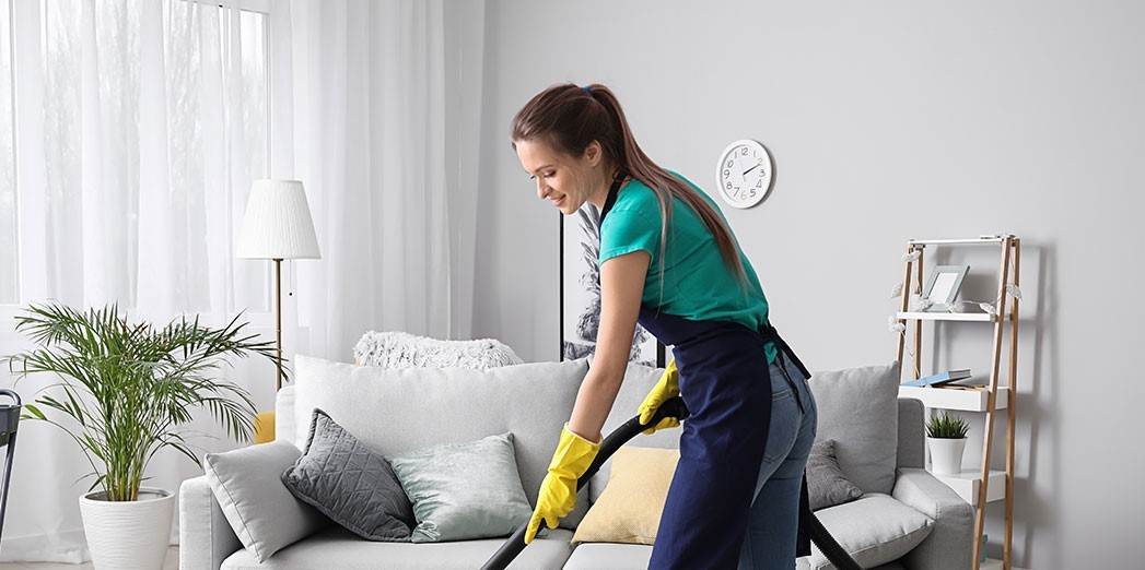 A woman who is cleaning her livingroom